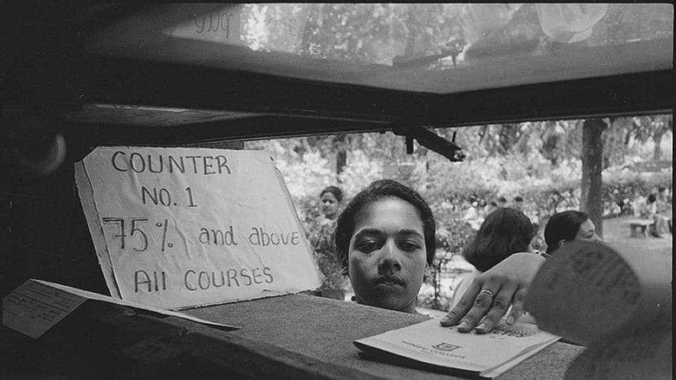A student submits her admission form at Delhi University in 1996. A gradual increase in cutoffs over the years has greatly increased the pressure on students vying for seats in top colleges.  (Prakash Singh / HT photo)