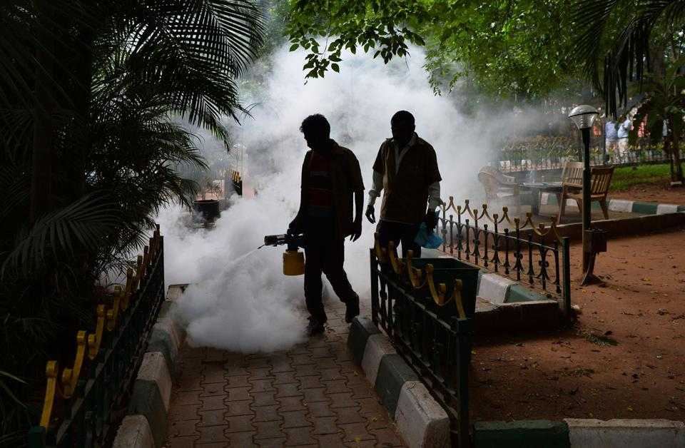 Municipal workers fumigate a park in a bid to kill off mosquitoes in Bengaluru. Over 18,700 cases of dengue have been reported in India this year.