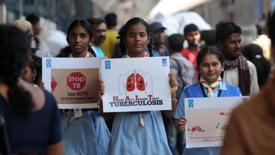 Schoolchildren hold placards during a tuberculosis awareness campaign at a railway station in Chennai in March 2017.