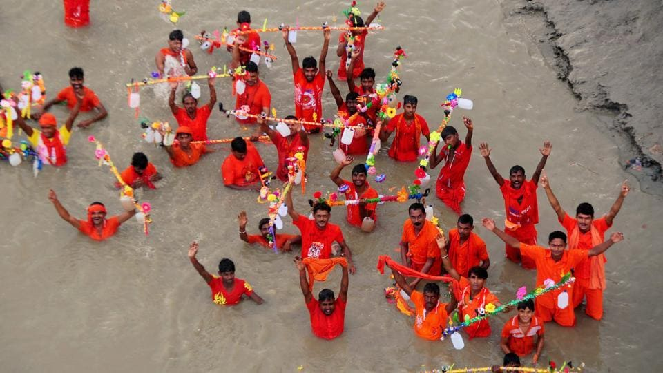 Kanwariyas taking a dip in the Ganga river during holy month of Shravan in Allahabad. (PTI)