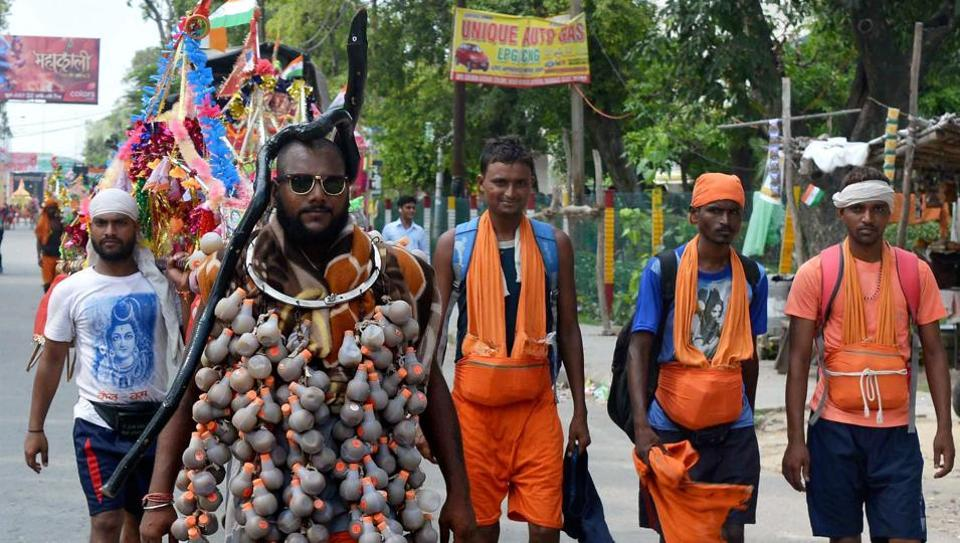 A Shiva devotee walks along with other Kanwariyas during their pilgrimage in Meerut.  (PTI Photo)