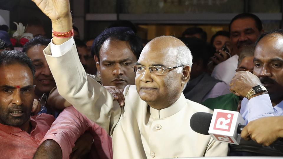 Ram Nath Kovind waves to media at the New Delhi airport. The 71-year-old becomes the 14th President of India having defeated Opposition's Meira Kumar.