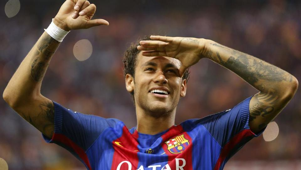 Barcelona's Neymar celebrates at the end of the Copa del Rey final soccer match between Barcelona and Alaves.