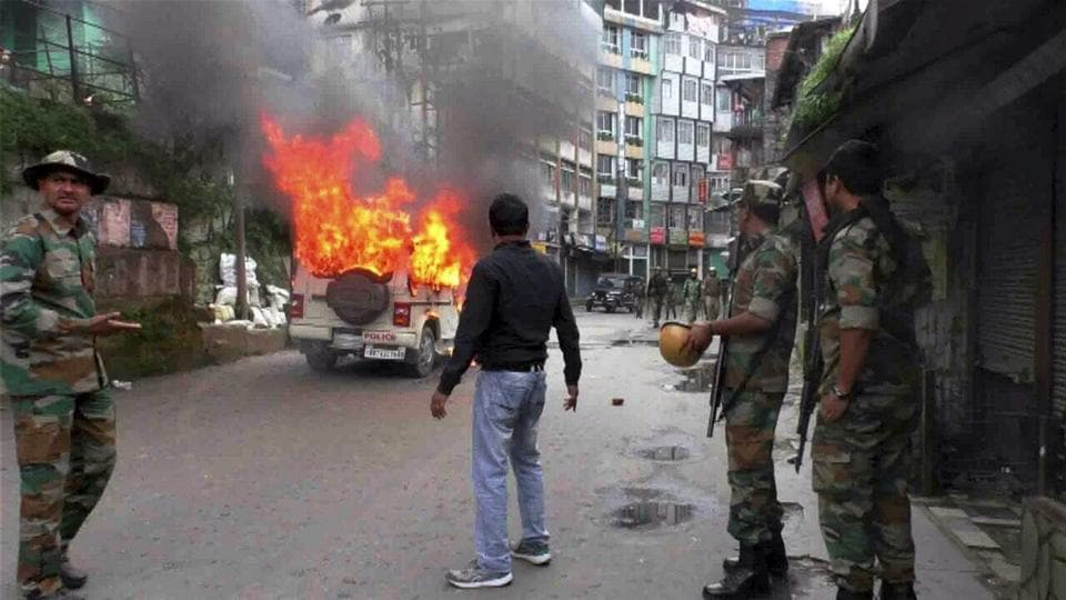 A vehicle in flames after it was set on fire by the protesters in Darjeeling on Wednesday.