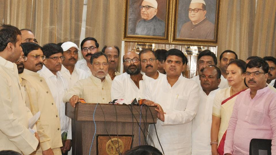 Opposition leaders addressing media persons after staging a walkout from the assembly.