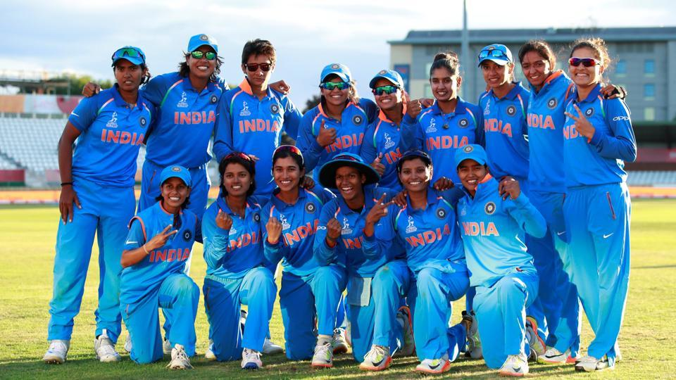 India celebrate winning their semi final against Australia in the World Cup