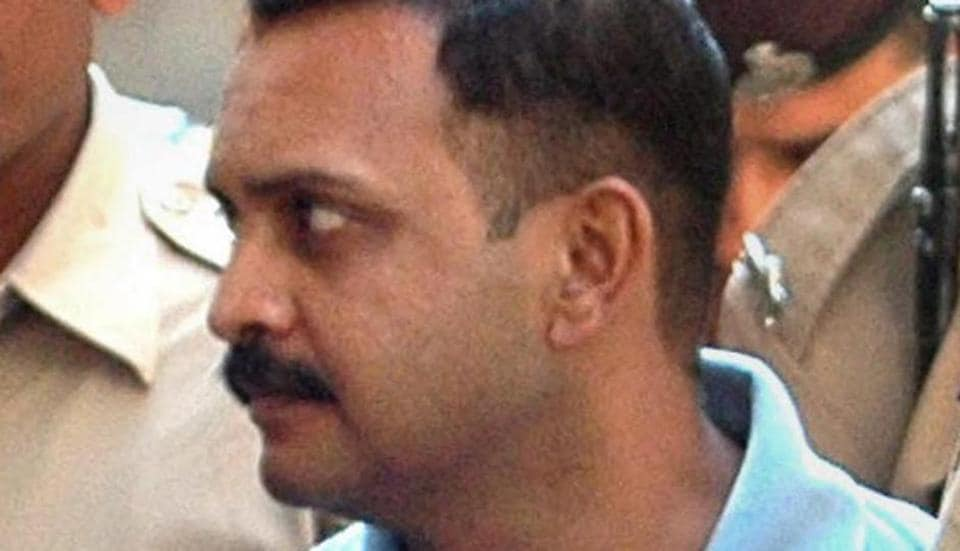 Malegaon blast case accused Lt Col Shrikant Prasad Purohit being taken to a session court in Mumbai.