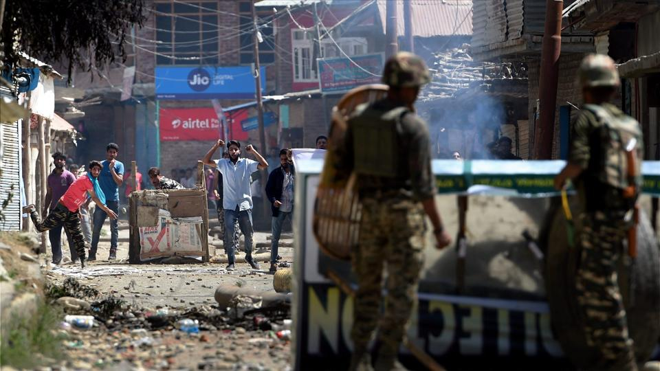 Protesters pelt stones on security forces during a protest in south Kashmir.