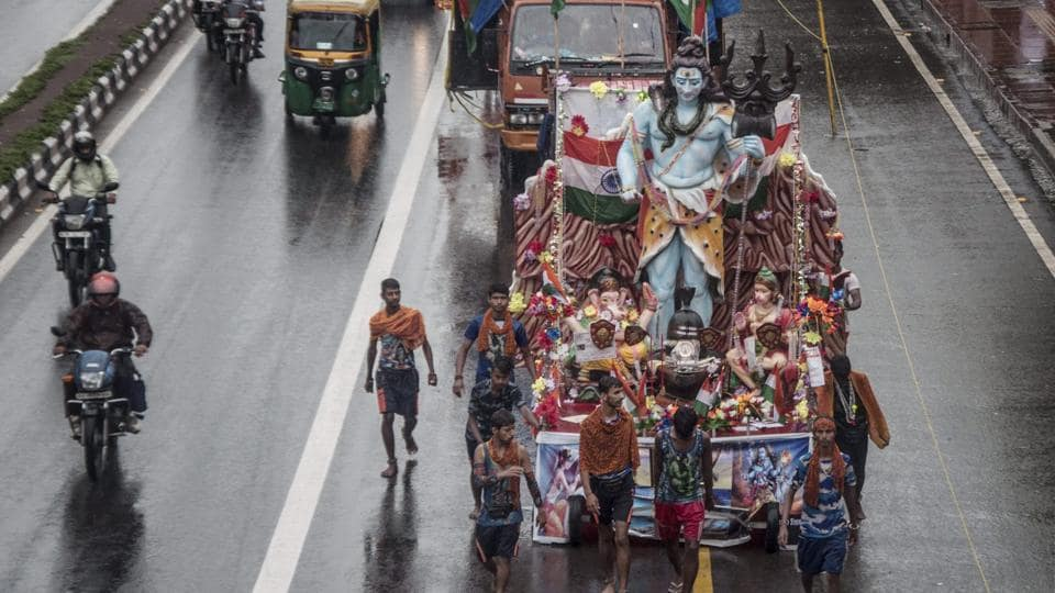 Millions of 'Kanwarias' from different states ,carry Kanwars on their shoulders, wearing orange dresses and walking hundreds of miles barefooted to bathe the 'Shivaling'. (PTI)