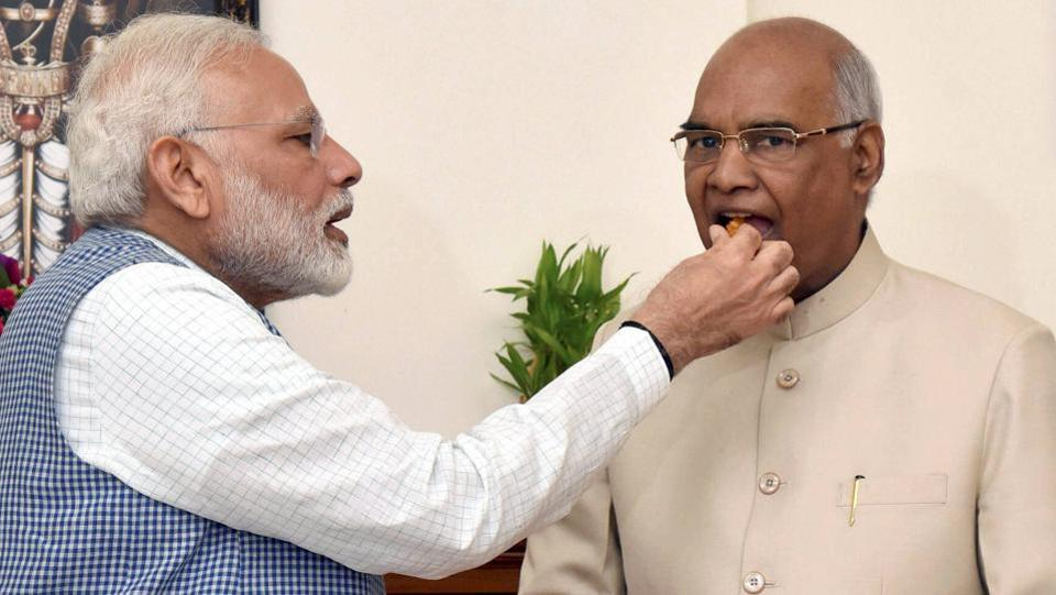 Prime Minister Narendra Modi offers sweets to Ram Nath Kovind, congratulating him on winning the election to the post of the 14th President of India. (PTI)