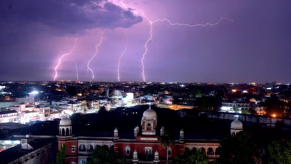 A lightning strike is observed during a storm above the city's skyline in Jabalpur. (PTI)