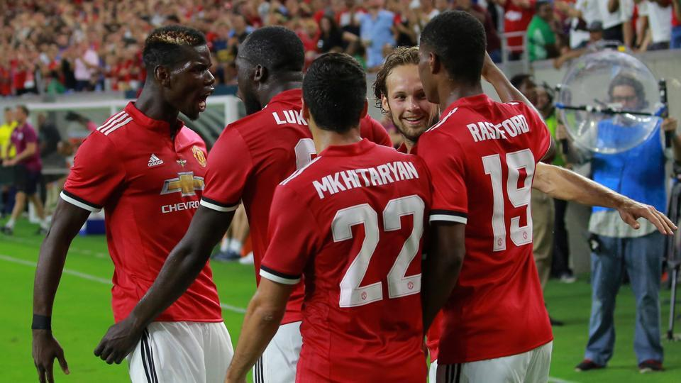 Manchester United players celebrate after defeating Manchester City 2-0 in the International Champions Cup.