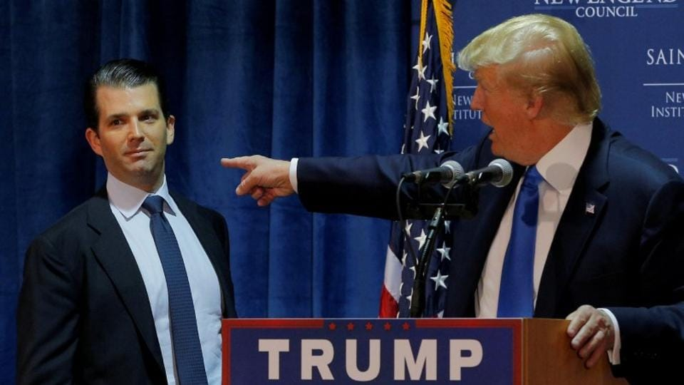 Donald Trump (right) welcomes his son Donald Trump Jr. to the stage during an event in New Hampshire.
