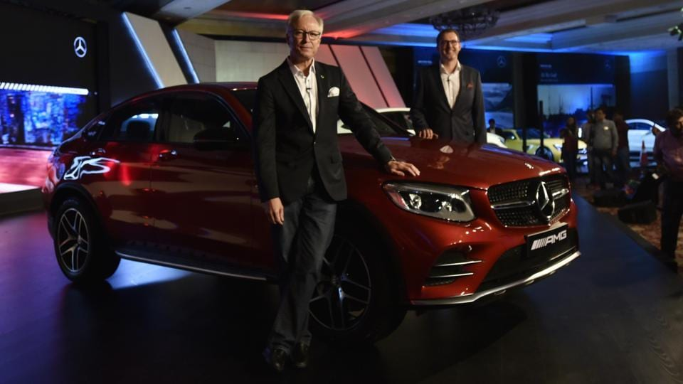 Mercedes AMG GLC 43  Coupe launched for the Indian market by Mr. Roland Folger (L) managing director and CEO and Mr. Michael (R) Jopp VP Sales and Marketing at a press conference in Delhi. Priced at 78.8 lacs(ex-showroom,India), this is part of the eight new models Mercedes India has launched in 2017 and the third AMG model.  (Vipin Kumar/HT PHOTO)
