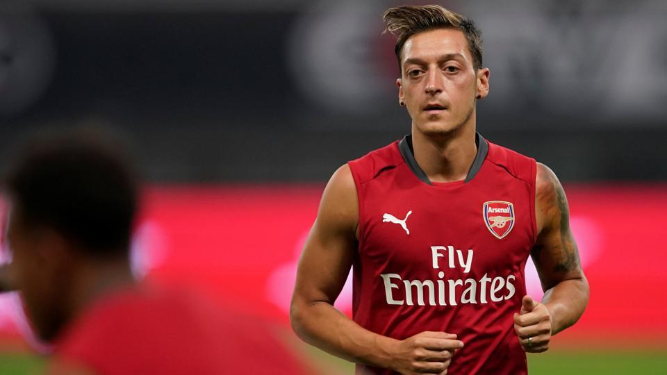 Arsenal's Mesut Ozil attends a training session.