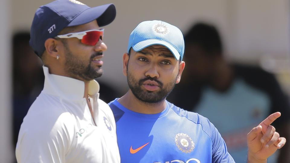 India's Shikhar Dhawan, left, and Rohit Sharma talk during a warm up game with Sri Lanka's board XI in Colombo. (AP)