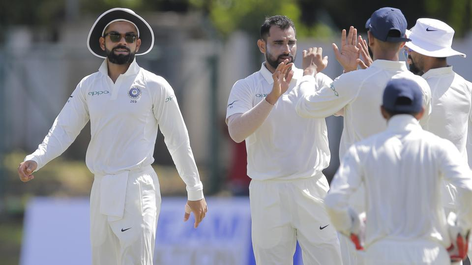 Virat Kohli, left, smiles as his teammates congratulate Mohammed Shami ,second left, for taking a wicket during a warm up game against Sri Lanka's Board XI. (AP)