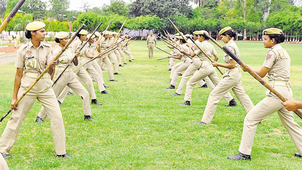 Female cadets showing their combative skills with 'lathis'.  (Bharat Bhushan/HT )