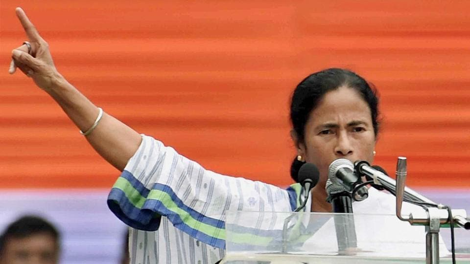Trinamool Congress chief Mamata Banerjee addresses a rally in Kolkata on Friday.