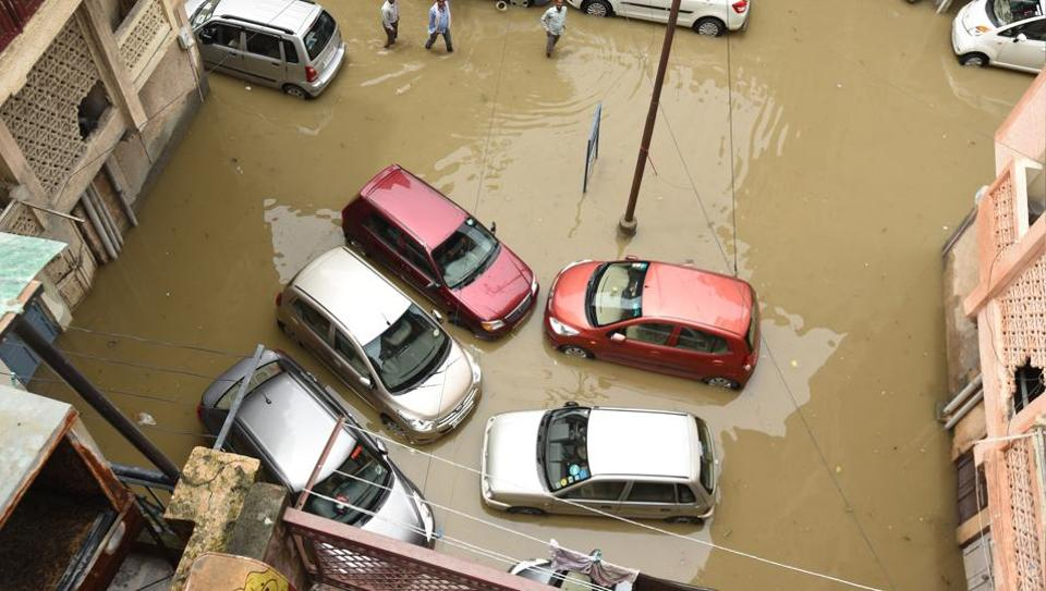 Many areas in the city, such as Jalvayu Vihar in Sector 25, were flooded after the rain on Thursday morning.