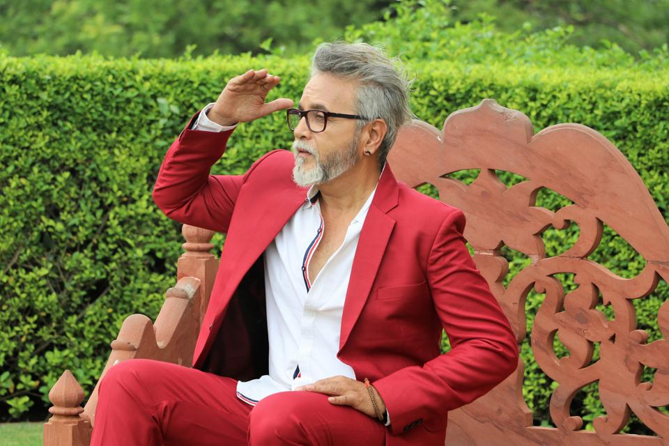 Model Dinesh Mohan, 59, has done a number of TV commercials and print ads. He took up modelling at the age of 57. The retired government servant looks all spic and span in a red suit.  His moustache earrings are adding to the look as he cuts a dapper figure.  (HT Photo/ Shara Ashraf)