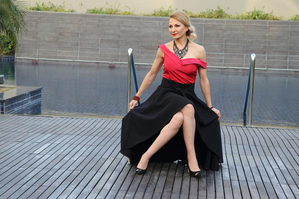 Fitness expert Vesna Jacob has done a lot of print ads and has also walked the ramp for leading names. She is wearing a red off-shouldered top teamed with a black skirt, Evoking vintage vibes, she has accessorised her look with a statement neckpiece and red lips.  (HT photo/ Shara Ashraf )