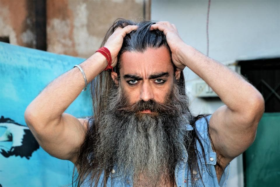 Model Daljit Sean Singh is one of the most sought after names in the modelling industry. At 47, he looks no less than a debonair. Keeping his sleevesless rugged denim shirt unbuttoned, he lets his eyes and hair do all the talking here.  (HT Photo/ Shara Ashraf)
