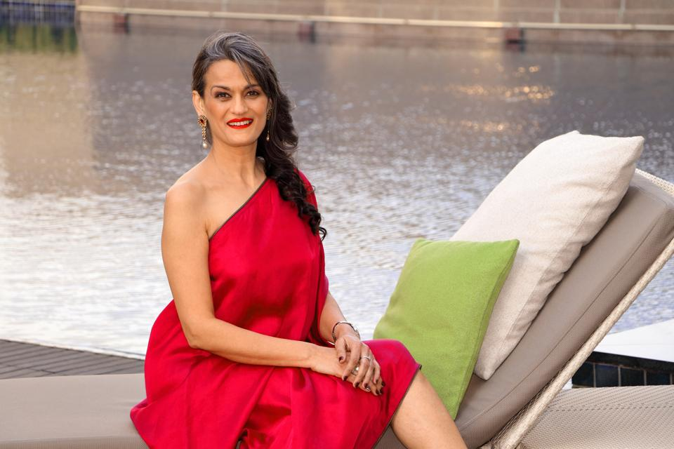 Designer Anu PD , 50, started modelling a few years ago to spread awareness for social causes. She is raising her style stakes in a one-shouldered  wine coloured dress by Payal Khandwala. She has spruced up her look with cherry red lips. ( Styling: Shara Ashraf) (HT Photo/ Shara Ashraf )