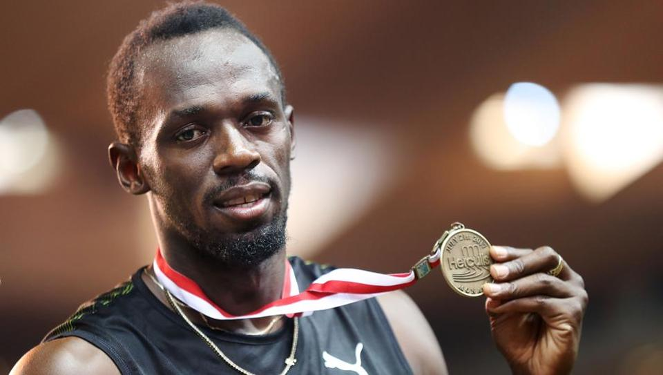 Usain Bolt poses with his gold medal after winning the men's 100m event at the IAAF Diamond League athletics meeting in Monaco. (AFP)