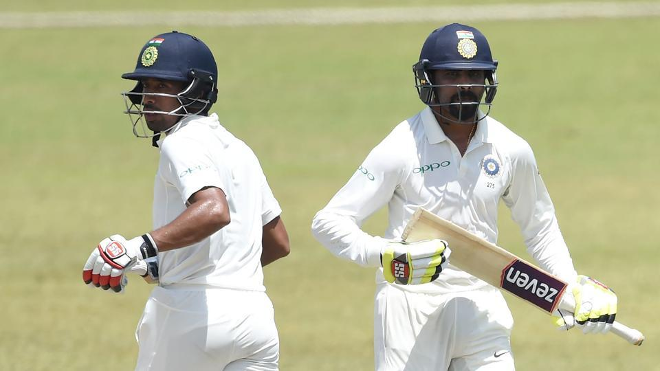 Wriddhiman Saha (L) spent some quality time in the middle courtesy an unbeaten 36-run knock.  (AFP)