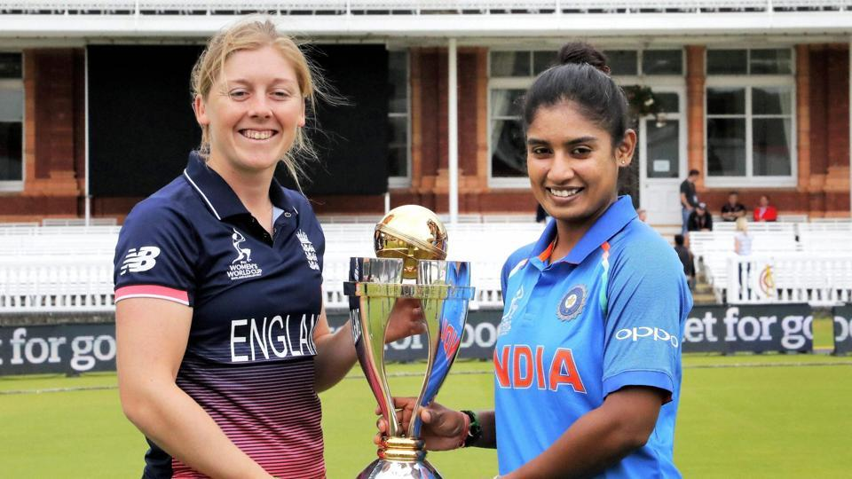 India skipper Mithali Raj and England skipper Heather Knight  pose with the ICC Women's World Cup trophy ahead of the final at Lord's. (PTI)