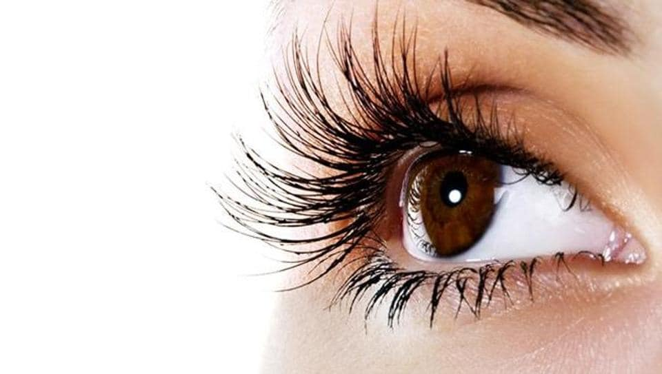A higher lifetime exposure to sunlight may increase the risk of developing eye freckles or dark spots on the iris.