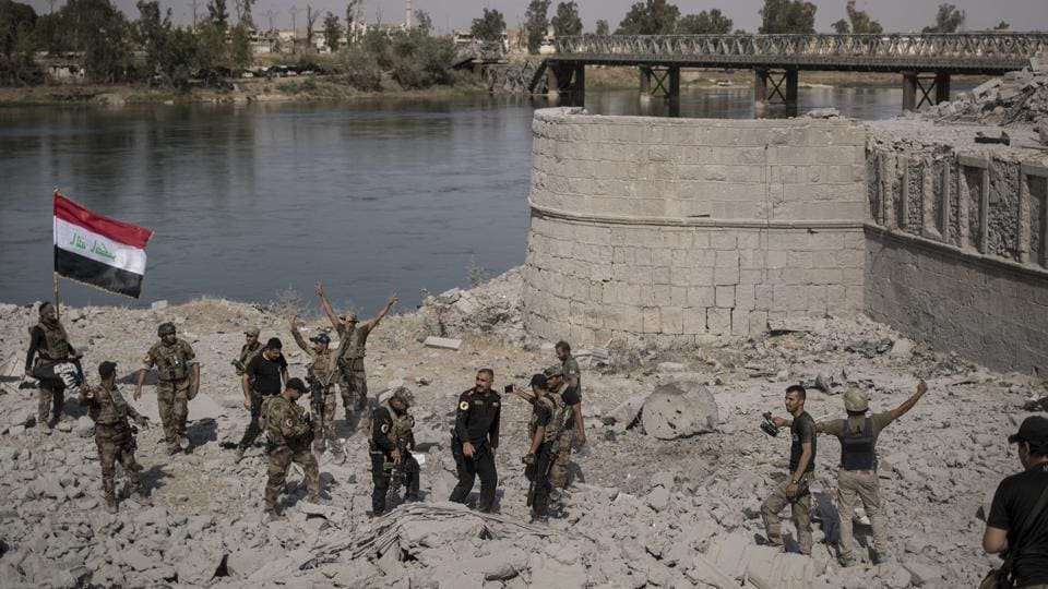 Iraqi Special Forces soldiers celebrate after reaching the bank of the Tigris river as their fight against Islamic State militants continues in parts of the Old City of Mosul, Iraq, on July 9.