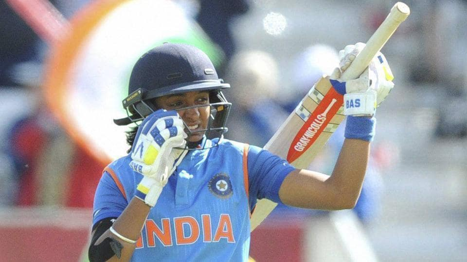 Harmanpreet Kaur celebrates after scoring 150 runs during the Women's Cricket World Cup semifinal match between Australia and India .