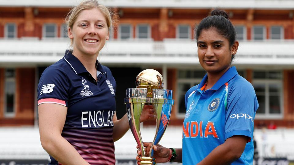 England's Heather Knight and India's Mithali Raj pose with the trophy ahead of Women's Cricket World Cup final.