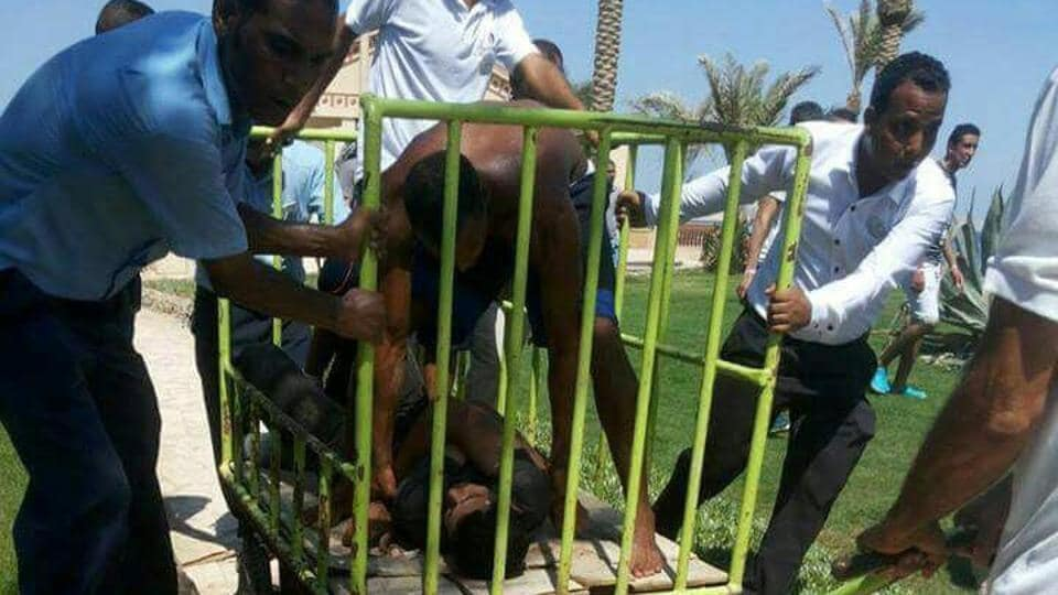 Workers and security detain the man accused of stabbing two German tourists to death and wounding four others during an attack of the Zahabia hotel resort in Hurghada, south of the capital Cairo, Egypt. (Mohamed Aly / REUTERS)