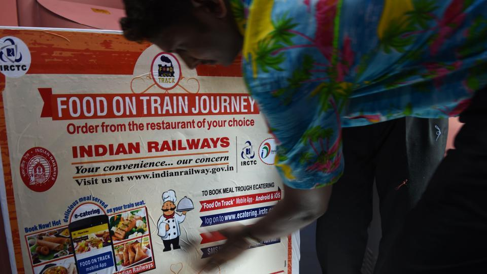 An employee prepares a food trolley onboard the Tejas Express luxury train during its first journey between Mumbai and Goa in Mumbai on May 22, 2017.