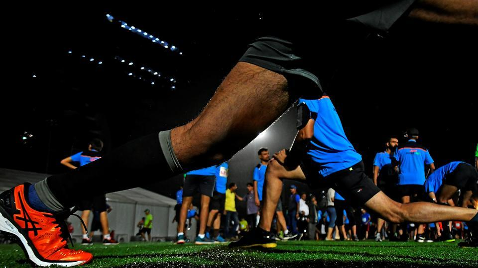 Participants do their warm-up. (Shashi S Kashyap/HT PHOTO)
