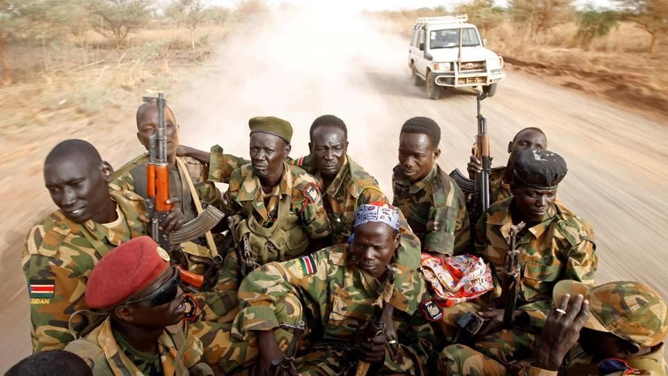 South Sudan's army, or the SPLA, soldiers drive in a truck on the frontline in Panakuach, Unity state . (Goran Tomasevic / REUTERS)