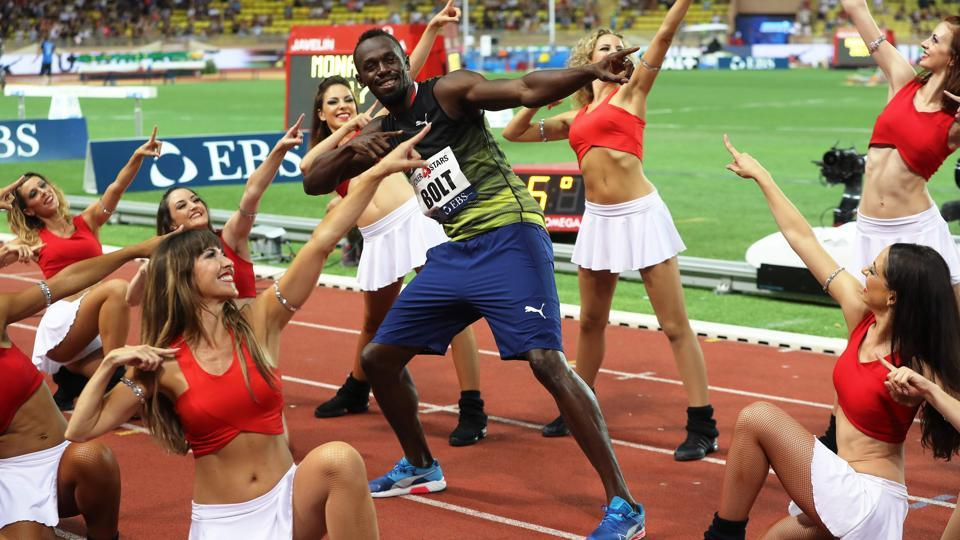 Jamaica's Usain Bolt (C) dances with pom-pom girls as he celebrates winning the men's 100m event at the IAAF Diamond League athletics meeting in Monaco. (Valery HACHE / AFP)