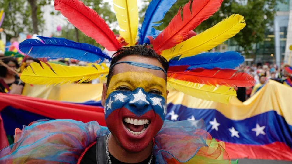 A participant from Venezuela takes part in Berlin's annual Christopher Street Day (CSD) gay pride parade on July 22, 2017. Gays and lesbians all around the World are celebrating the Christopher Street Day (CSD) gay and lesbian pride parade. (John MACDOUGALL / AFP)