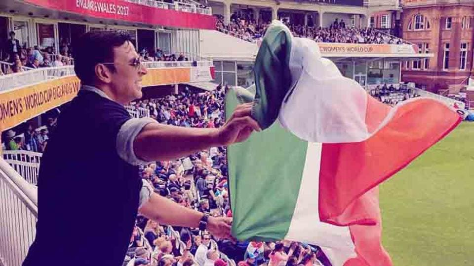 Akshay Kumar waves the national flag at the Women's World Cup Final.