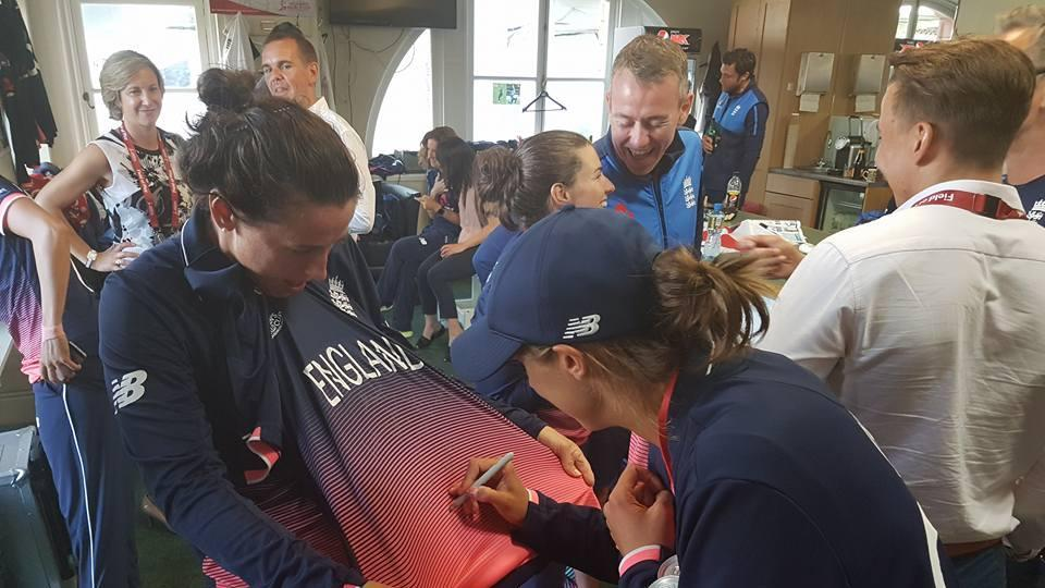 England players sign jerseys in the dressing room after the win. (ICC FACEBOOK)