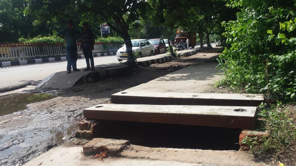 The drain in which Anil Gupta fell during his evening walk on Sunday. The drain was reportedly covered after Gupta died.