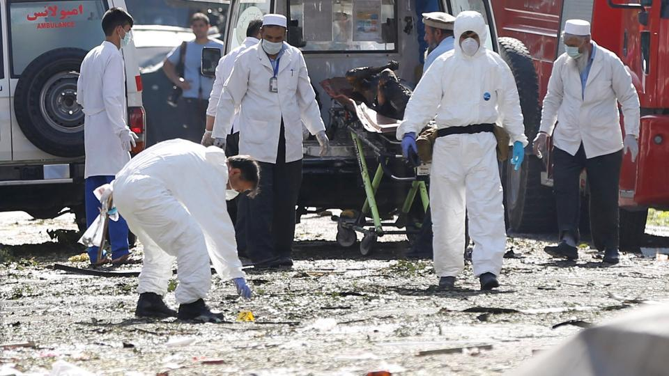 Afghan investigators work at the site of a suicide attack in Kabul. (Omar Sobhani / REUTERS)