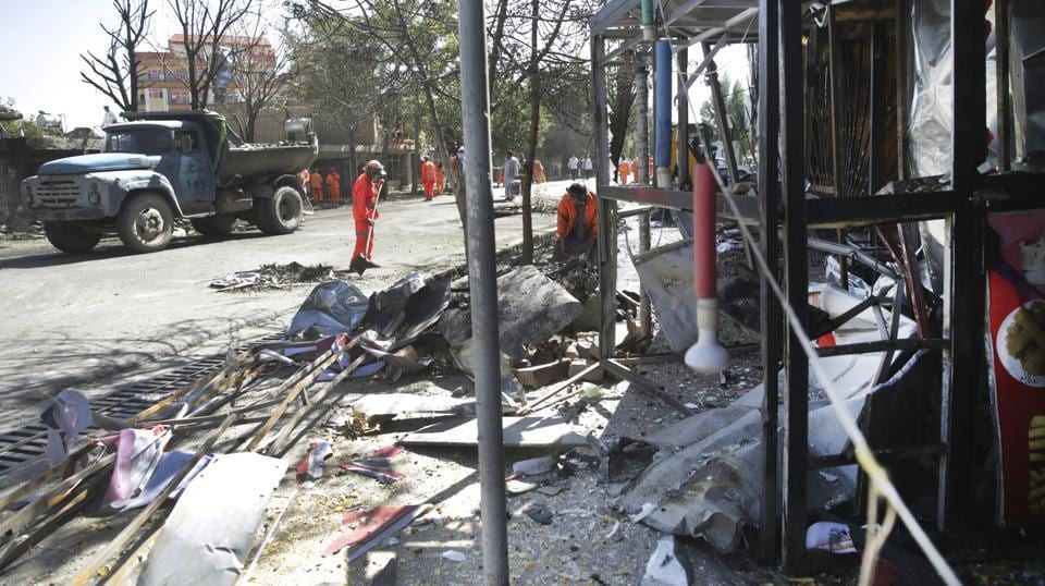The bomb went off close to the home of Mohammad Mohaqeq, a prominent Hazara politician and deputy to the government's chief executive. (Massoud Hossaini / AP)