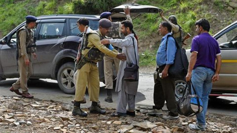 Security personnel at Nuwun base Camp in South Kashmir frisk yatris and local residents before they head towards the holy cave shrine following a militant attack on a bus in July.