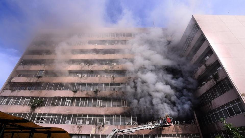 Firefighters douse flames at Delhi's Lok Nayak Bhawan after a fire broke out at the building's fourth floor on Monday.
