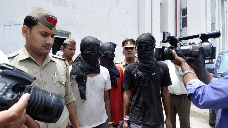 Police arrested the four men after an encounter on Sunday morning in Greater Noida.