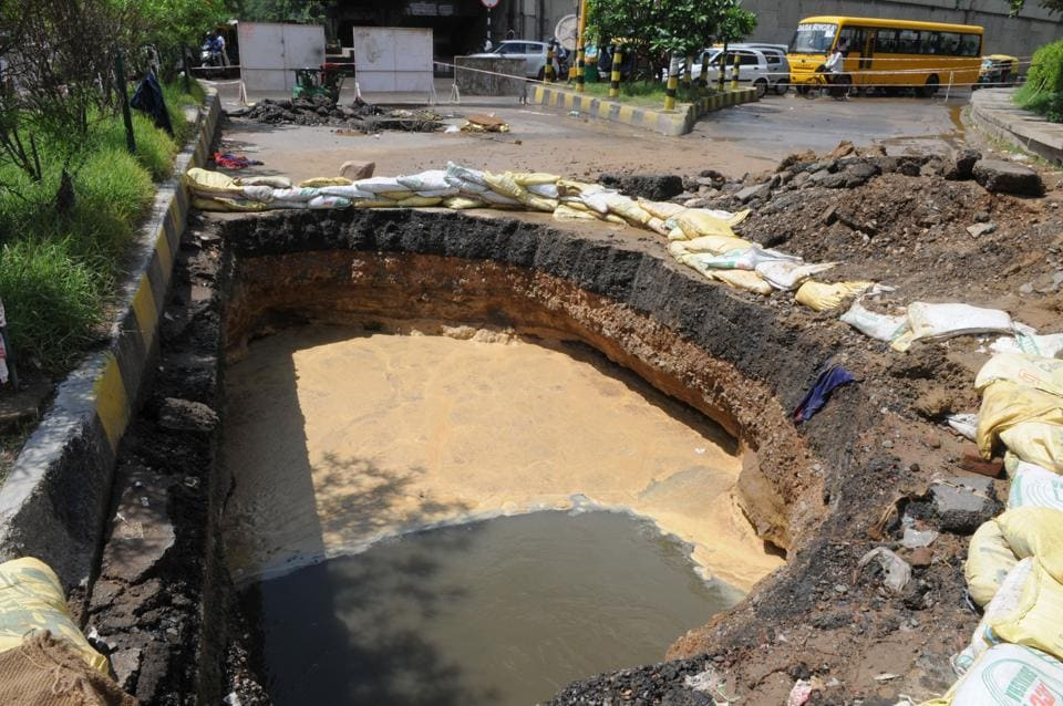 Portion of the Jharsa Road that caved in after the sewer line burst.
